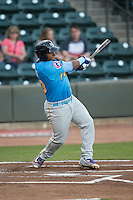 Jeffrey Baez (33) of the Myrtle Beach Pelicans follows through on his swing against the Winston-Salem Dash at BB&T Ballpark on April 18, 2016 in Winston-Salem, North Carolina.  The Pelicans defeated the Dash 6-4.  (Brian Westerholt/Four Seam Images)