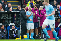 Sergio Aguero of Manchester City receives treatment for a bloodied nose during the Premier League match between Crystal Palace and Manchester City at Selhurst Park, London, England on 31 December 2017. Photo by Andy Rowland.
