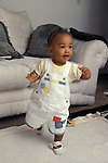 Richmond, Ca  African American baby twelve months old just starting to walk at her home  MR