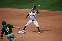 UCF Knights shortstop Brandon Hernandez (7) waits to receive a throw as Alex Milone (10 slides in during a game against the Siena Saints on February 17, 2019 at John Euliano Park in Orlando, Florida.  UCF defeated Siena 7-1.  (Mike Janes/Four Seam Images)