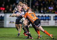 Picture by Alex Whitehead/SWpix.com - 06/03/2015 - Rugby League - First Utility Super League - Castleford Tigers v Wigan Warriors - the Mend A Hose Jungle, Castleford, England - Wigan's Larne Patrick is tackled by Castleford's Adam Milner and Scott Wheeldon.
