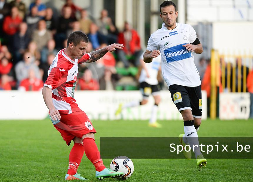 KSV Roeselare - R Antwerp FC : Anthony Di Lallo (links) aan de bal voor Marcos Camozzato (r) <br /> foto VDB / BART VANDENBROUCKE