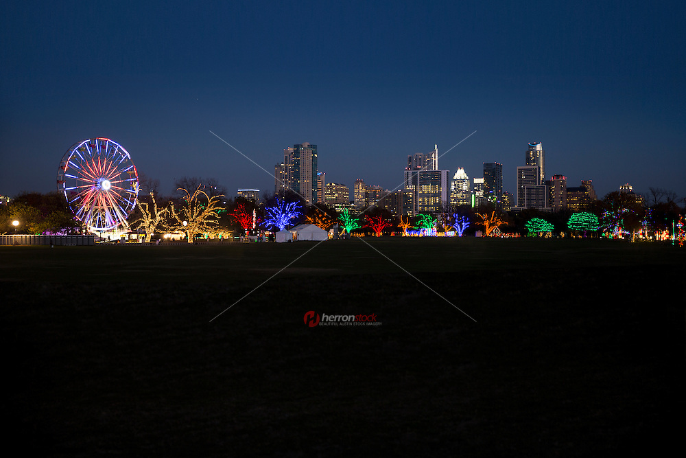 Framed by the Austin skyline, the Ferris wheel at the Austin Trail of Lights is lit each evening in December to celebrate the Christmas Holiday Season. The event brings thousands of visitors from all over the country to witness this enourmous tree lighting spectacle.