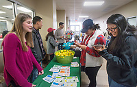 NWA Democrat-Gazette/BEN GOFF @NWABENGOFF<br /> Kat Leis (from left), Student Ambassadors and Government Association vice president from Bella Vista, and Luis Rodriguez, SAGA representative from Fayetteville, hand out stress balls and face masks to students Guadalupe Lopez of Avoca and Alondra Miranda of Berryville Wednesday, Dec. 5, 2018, during the Student Ambassadors and Government Association's finals stress relief party in Burns Hall at Northwest Arkansas Community College in Bentonville. Representatives from SAGA were offering snacks, coffee, hot chocolate, stress balls, and chair massages Tuesday and Wednesday as students prepare for their final exams next week.
