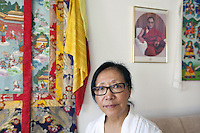 "Switzerland. Canton Thurgau. Littenheid. Dicki Shitsetsang at home with the picture of the Dalai Lama. The elderly swiss tibetan woman is an Aeschimann's child who arrived 50 years ago in Switzerland to receive custody on a private initiative by an influential Swiss industrialist, Charles Aeschimann. In 1962, Charles Aeschimann agreed with the Dalai Lama to take 200 children and place them in Swiss foster homes and give them a chance for a better life and a good education. Most of the children still had parents in exile or in Tibet, just a few were orphans. The 14th and current Dalai Lama is Tenzin Gyatso, recognized since 1950. He is the current Dalai Lama, as well as the longest-lived incumbent, well known for his lifelong advocacy for Tibetans inside and outside Tibet. Dalai Lamas are amongst the head monks of the Gelug school, the newest of the schools of Tibetan Buddhism. The Dalai Lama, also called "" Ocean of Wisdom"" is considered as the incarnation of Chenresi, the Bodhisattva of compassion who is also the protective deity of Tibet. 26.02.2015 © 2015 Didier Ruef"