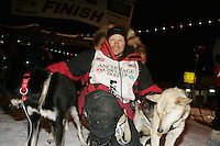 Doug Swingley finishes the Iditarod in 2nd place at the finish line in Nome
