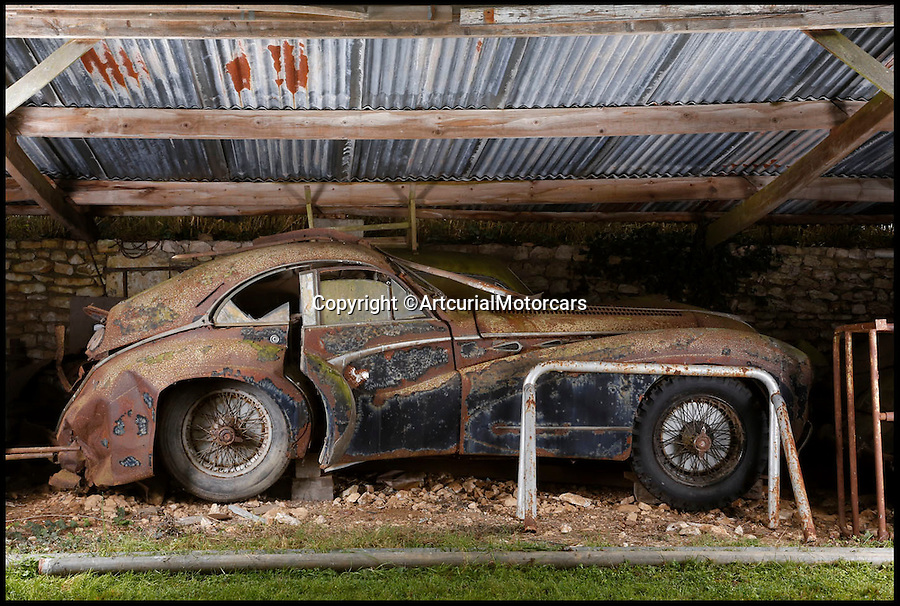 BNPS.co.uk (01202 558833)<br /> Pic: ArtcurialMotorcars/BNPS<br /> <br /> ***Please Use Full Bylne***<br /> <br /> Talbot Lago T26 Grand Sport Coupe Saoutchik.<br /> An incredible £12 million treasure trove of classic cars has been discovered after spending 50 years languishing in storage on a farm.<br /> <br /> The 60 rusting motors, which include a vintage Ferrari California Spider, a Bugatti and a very rare Maserati, were found gathering dust and hidden under piles of newspapers in garages and outbuildings at a property in France.<br /> <br /> The 'once-in-a-lifetime' find has been compared to a major archaeological discovery, on a par with Tutankhamun's tomb.