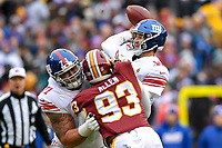 Landover, MD - December 9, 2018: \g10 throws the football while under pressure from Washington Redskins defensive end Jonathan Allen (93) during game between the New York Giants and Washington Redskins at FedEx Field in Landover, MD. The Giants defeated the Redskins 40-16 dropping the Redskins to 6-7 on the season. (Photo by Phillip Peters/Media Images International)
