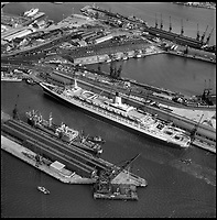 BNPS.co.uk (01202 558833)<br /> Pic: Aerofilms/HistoricEngland/BNPS<br /> <br /> Southampton - SS Queen Elizabeth 2, 1 February 1969.<br /> <br /> Stunning historic aerial photos of seaside towns, naval bases, ports and shipyards which tell the story of Britain's once-great maritime tradition feature in a new book.<br /> <br /> The fascinating archive of black and white images includes views from a bygone age such as Brighton's famous West Pier, Grimsby's burgeoning fishing fleet, and London's dock yards.<br /> <br /> Iconic ships were also captured from the skies including the Cutty Sark in its final seaworthy years on the Thames, HMY Britannia in 1959, the RMS Queen Mary in 1946 and the SS Queen Elizabeth in 1969 about to make her maiden voyage.<br /> <br /> England's Maritime Heritage from the Air, by Peter Waller, is published by English Heritage and costs &pound;35.
