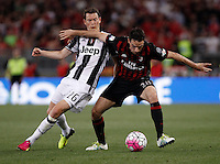 Calcio, finale Tim Cup: Milan vs Juventus. Roma, stadio Olimpico, 21 maggio 2016.<br /> AC Milan&rsquo;s Giacomo Bonaventura, right, is challenged by  Juventus&rsquo; Stephan Lichsteiner during the Italian Cup final football match between AC Milan and Juventus at Rome's Olympic stadium, 21 May 2016.<br /> UPDATE IMAGES PRESS/Isabella Bonotto