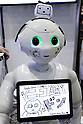 "A SoftBank robot Pepper on display during the Niconico Douga fan event at Makuhari Messe International Exhibition Hall on April 25, 2015, Chiba, Japan. The event includes special attractions such as J-pop concerts, Sumo and Pro Wrestling matches, cosplay and manga and various robot performances and is broadcast live on via the video-sharing site. Niconico Douga (in English ""Smiley, Smiley Video"") is one of Japan's biggest video community sites where users can upload, view, share videos and write comments directly in real time, creating a sense of a shared watching. According to the organizers more than 200,000 viewers for two days will see the event by internet. The popular event is held in all 11 halls of the huge Makuhari Messe exhibition center from April 25 to 26. (Photo by Rodrigo Reyes Marin/AFLO)"