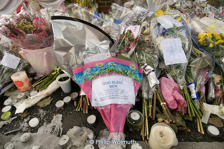 Flowers, candles and messages left at the site of the fatal stabbing of teenager Ben Kinsella in North Road, Islington, London.