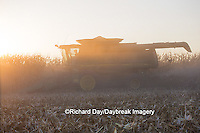 63801-06805 John Deere combine harvesting corn at sunset, Marion Co., IL