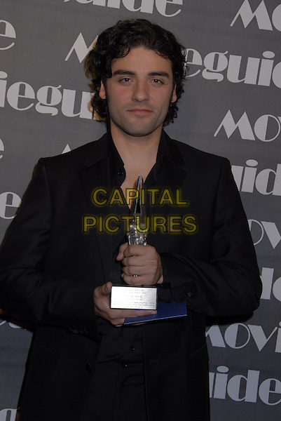 OSCAR ISAAC.The 15th Annual Movieguide Faith and Values Awards held at the Beverly Wilshire Hotel, Beverly Hills, California, USA..February 20th, 2007.half length black jacket award trophy.CAP/ADM/GB.©Gary Boas/AdMedia/Capital Pictures