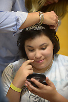 NWA Democrat-Gazette/ANDY SHUPE<br /> Nina Hadley of Bentonville smiles Friday, Feb. 9, 2018, as she admires a tiara and a hairstyling that she received from stylist Brittany Lewis of The Parlor Salon in Fayetteville during the Night to Shine, a prom night for people with special needs ages 14 and older, at Cross Church in Springdale. The event, which is sponsored by the Tim Tebow Foundation, features hair and makeup assistance, limousine rides, a dinner and dancing.