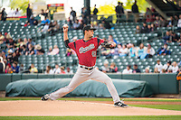 Jake Dunning (43) of the Sacramento River Cats delivers a pitch to the plate against the Salt Lake Bees in Pacific Coast League action at Smith's Ballpark on April 17, 2015 in Salt Lake City, Utah.  (Stephen Smith/Four Seam Images))