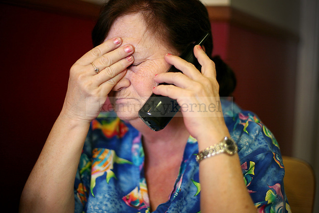 After a busy morning rush, owner Mary Lou Campbell answers a phone call for an order.