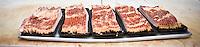Freshly cut bacon on the cutting board in Elias' Butcher Shop in Roanoke Rapids, North Carolina.