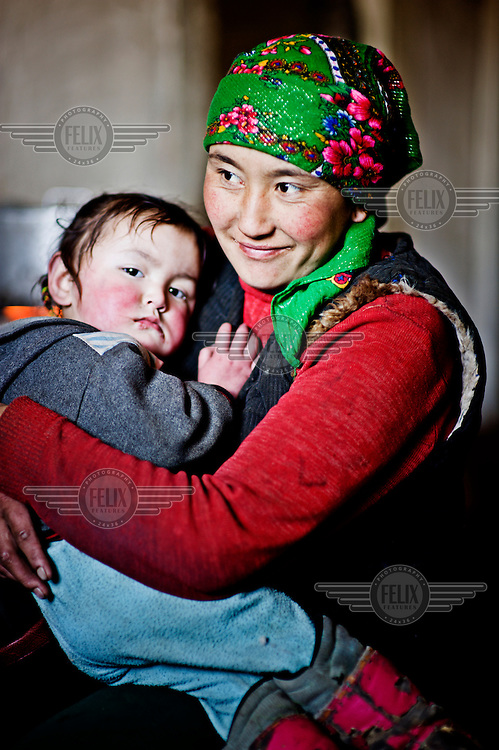 A young woman and her son in their home.
