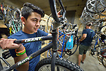 Mohammad Khilo, a refugee from Syria, works at The Common Wheel in Lancaster, Pennsylvania. The community bike center, which collaborates with Church World Service, helps resettled refugees to own, maintain, and use bicycles.<br /> <br /> Photo by Paul Jeffrey for Church World Service.