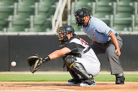 Catcher Rafael Vera #37 of the Kannapolis Intimidators sets a target as home plate umpire Jose Esteras looks over his shoulder during the South Atlantic League game against the Delmarva Shorebirds at Fieldcrest Cannon Stadium on August 7, 2011 in Kannapolis, North Carolina.  The Intimidators defeated the Shorebirds 8-3.   (Brian Westerholt / Four Seam Images)