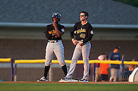 West Virginia Black Bears third baseman Ke'Bryan Hayes (3) and coach Adam Godwin (48) during a game against the Batavia Muckdogs on August 30, 2015 at Dwyer Stadium in Batavia, New York.  Batavia defeated West Virginia 8-5.  (Mike Janes/Four Seam Images)
