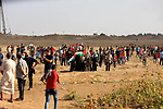 Palestinian protesters gather during clashes with Israeli troops in tents protest where Palestinian demand the right to return to their homeland at the Israel-Gaza border, in east of Gaza City on July 20, 2018. Photo by Dawoud Abo Alkas