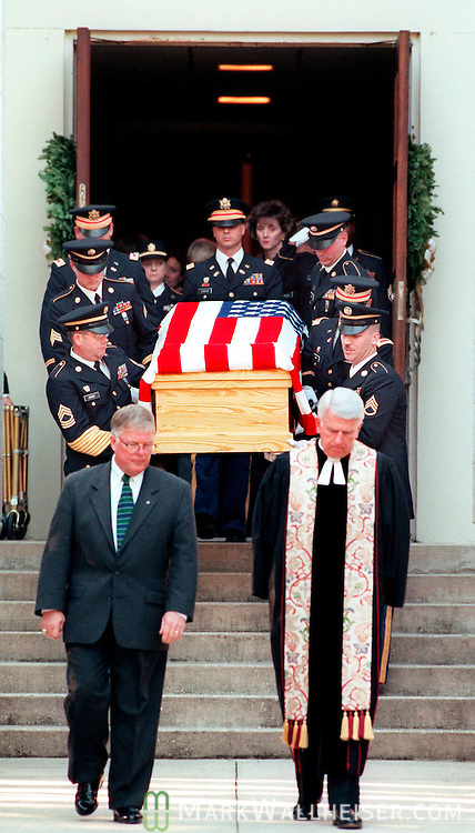 Paster Ed Ayers, of Christ Presbyterian Church (R) leads .the Honor Guard with the body of Gov. Lawton Chiles down the .steps of the Faith Presbyterian Church after the service in Tallahassee, Florida December 16, 1998..