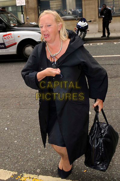 DEBORAH MEADEN .Arriving at BBC Radio 2, London, England..July 20th, 2011.full length black coat bag purse eyes closed funny mouth open.CAP/IA.©Ian Allis/Capital Pictures.