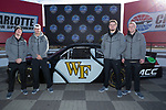 (L-R) Alex Bachman, Dom Maggio, Brandon Chapman, and Garrett Wilson of the Wake Forest Demon Deacons pose for a photo in front of a NASCAR race car in Victory Circle at the Charlotte Motor Speedway on December 26, 2017 in Concord, North Carolina.  (Brian Westerholt/Sports On Film)