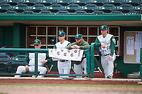 Fort Wayne TinCaps pitching coach Burt Hooton (32), coach Raul Padron, hitting coach Lance Burkhart, and manager Anthony Contreras (10) during the second game of a doubleheader against the Great Lakes Loons on May 11, 2016 at Parkview Field in Fort Wayne, Indiana.  Great Lakes defeated Fort Wayne 5-0.  (Mike Janes/Four Seam Images)