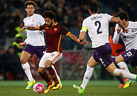 Calcio, Serie A: Roma vs Fiorentina. Roma, stadio Olimpico, 4 marzo 2016.<br /> Roma&rsquo;s Mohamed Salah, second from left, is challenged by Fiorentina&rsquo;s Marcos Alonso, left, Gonzalo Rodriguez and Davide Astori, right, during the Italian Serie A football match between Roma and Fiorentina at Rome's Olympic stadium, 4 March 2016.<br /> UPDATE IMAGES PRESS/Riccardo De Luca