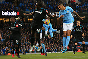 3rd December 2017, Etihad Stadium, Manchester, England; EPL Premier League football, Manchester City versus West Ham United; Danilo of Manchester City  heads down on goal and its saved