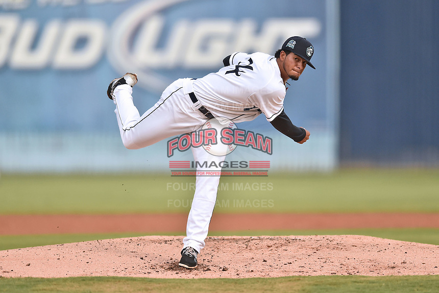 Asheville Tourists starting pitcher Jesus Tinoco (34) delivers a pitch during game one of the Southern Division South Atlantic League Playoffs against the Savannah Sand Gnats on September 9, 2015 in Asheville, North Carolina. The Tourists defeated the Sand Gnats 5-1. (Tony Farlow/Four Seam Images)