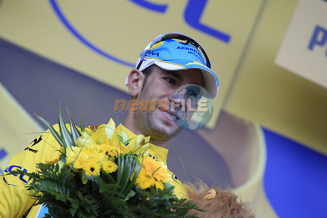 Race leader Yellow Jersey Vincenzo Nibali (ITA) Astana increases his lead at the end of Stage 5 of the 2014 Tour de France running 155.5km from Ypres to Arenberg. 9th July 2014.<br /> Picture: Eoin Clarke www.newsfile.ie