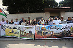 Palestinians take part in a protest against Israel's newly-installed security measures at the entrance to the al-Aqsa mosque compound, in front of Red cross office in Gaza city on July 24, 2017. Photo by Mohammed Asad