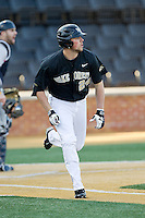 Charlie Morgan (24) of the Wake Forest Demon Deacons hustles down the first base line against the Georgetown Hoyas at Wake Forest Baseball Park on February 16, 2014 in Winston-Salem, North Carolina.  The Demon Deacons defeated the Hoyas 3-2.  (Brian Westerholt/Four Seam Images)