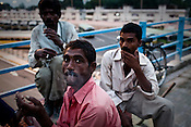 Indian labourers take a break from work outside the main stadium for the approaching 19th Commonwealth Games 2010 in New Delhi, India.