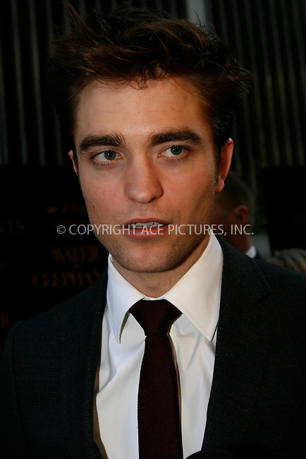 WWW.ACEPIXS.COM . . . . .  ....April 17 2011, New York City....Actor Robert Pattinson arriving at the 'Water For Elephants' premiere at the Ziegfeld Theatre on April 17, 2011 in New York City.....Please byline: NANCY RIVERA- ACEPIXS.COM.... *** ***..Ace Pictures, Inc:  ..Tel: 646 769 0430..e-mail: info@acepixs.com..web: http://www.acepixs.com