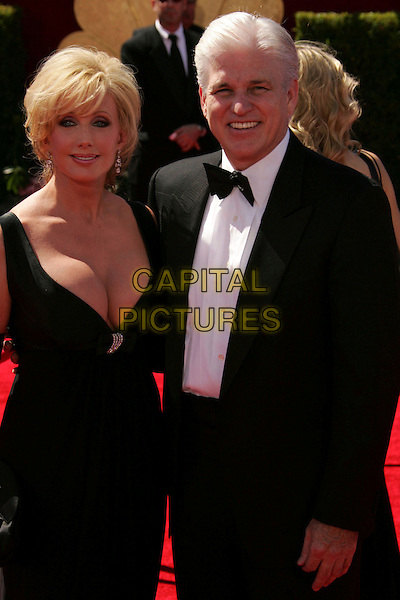 MORGAN FAIRCHILD & GUEST.58th Annual Primetime Emmy Awards held at the Shrine Auditorium, Los Angeles, California, USA..August 27th, 2006.Ref: ADM/RE.half length black dress cleavage gloves .www.capitalpictures.com.sales@capitalpictures.com.©Russ Elliot/AdMedia/Capital Pictures.