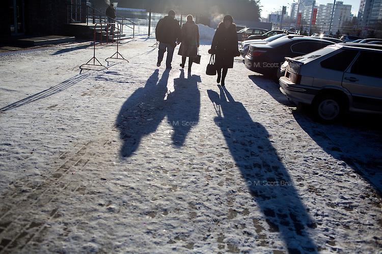 People walk along the street in Ufa, Bashkortostan, Russia.