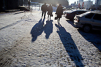 People walk along the street in Ufa, Bashkortostan, Russia.