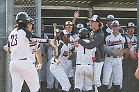 Etiwanda High School Eagles shortstop Cody Freeman (1) is mobbed by teammates after scoring a run during the First Round of California Division 1 Playoffs against the JSerra Catholic High School Lions at Etiwanda High School on May 18, 2018 in Rancho Cucamonga, California. Etiwanda High School defeated JSerra Catholic High School 8-4. (Zachary Lucy/Four Seam Images)