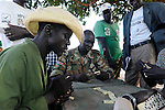 SUED-SUDAN  Bahr el Ghazal region , Lakes State, Rumbek , ehemalige Kaempfer und Veteranen der SPLA suedsudanesischen Befreiungsarmee im War Heroes Center , Abraham Magok (green shirt) / SOUTH SUDAN  Bahr al Ghazal region , Lakes State, town Rumbek , war heros of SPLA in Heroes Center