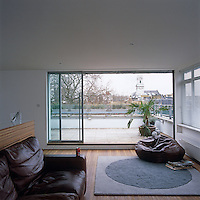 The main living area takes full advantage of the penthouse's elevated position and the terrace overlooks the trees and buildings around Hoxton Square