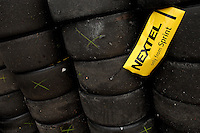 Mar 31, 2007; Martinsville, VA, USA; A Nextel logo hangs from a stack of tires during Nascar Nextel Cup Series practice for the Goody's Cool Orange 500 at Martinsville Speedway. Martinsville marks the second race for the new car of tomorrow. Mandatory Credit: Mark J. Rebilas..