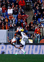 Calcio, Serie A: Roma-Genoa. Roma, stadio Olimpico, 12 gennaio 2014.<br /> AS Roma midfielder Alessandro Florenzi, left, scores on an overhead kick as Genoa defender Sime Vrsaljko, of Croatia, tries to stop him during the Italian Serie A football match between AS Roma and Genoa, at Rome's Olympic stadium, 12 January 2014. <br /> UPDATE IMAGES PRESS/Isabella Bonotto