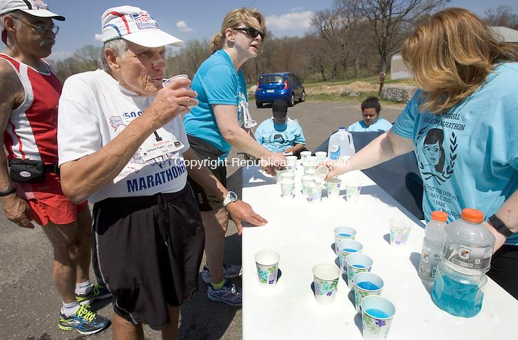 WATREBURY CT. 04 May 2015-050415SV05-Race organizer Gene DeFronzo of Cheshire takes a break during the Oh Boy Marathon in Hamilton Park in Waterbury Monday. <br /> Steven Valenti Republican-American