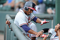 Third baseman Carlos Franco (11) of the Rome Braves is congratulated after hitting a home run in a game against the Greenville Drive on Sunday, August 3, 2014, at Fluor Field at the West End in Greenville, South Carolina. Rome won, 4-2. (Tom Priddy/Four Seam Images)