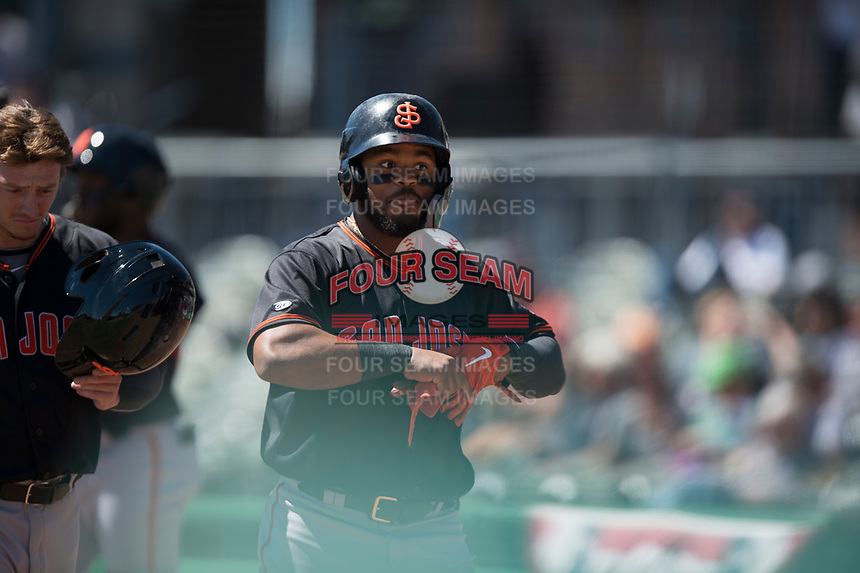 San Jose Giants center fielder Heliot Ramos (13) reacts after after hitting a home run during a California League game against the Stockton Ports on April 9, 2019 in Stockton, California. San Jose defeated Stockton 4-3. (Zachary Lucy/Four Seam Images)